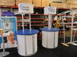 Custom Round Kiosks with Tension Fabric Header and Storage -- Image 1