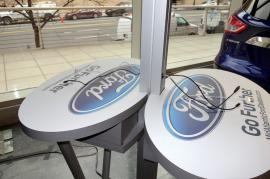 Cell Phone Charging Stations with Dual Monitors and Graphics at Auto Dealership -- Image 1