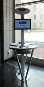 Cell Phone Charging Stations with Dual Monitors and Graphics at Auto Dealership -- Image 3
