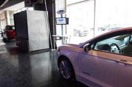 Cell Phone Charging Stations with Dual Monitors and Graphics at Auto Dealership -- Image 4