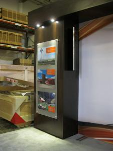 Custom eSmart with 10x10 Conversion. Includes Large SEG and 3D Header Graphics, Storage Closet and Laminated Display Counters w/ Frosted Acrylic Work Surfaces, Large Monitor Mount, and Recessed LED Lighting -- Image 2