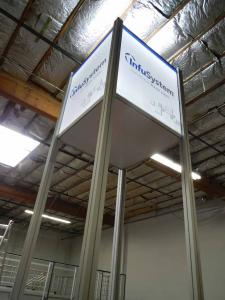 RENTAL:  Custom 20 ft. High Tower with SEG LED Backlit and Sintra Infill Graphics. Includes Locking Door, Large Monitor, and Black Laminated Shelf -- Image 3