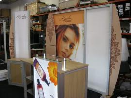 eSmart Modified ECO-1048 with EcoBoard Wings, Modified ECO-35C Counter with Backlit Graphics, Acrylic Shelving, and SEG Fabric Graphics and a Custom Kiosk with Storage -- Image 1