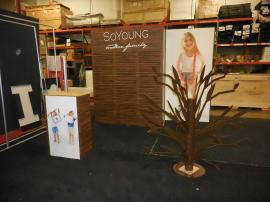 Custom Modular Exhibit with Slatwall, Storage, Reception Counter, Backlit Graphics, and Metal Product Display (tree) -- Image 4