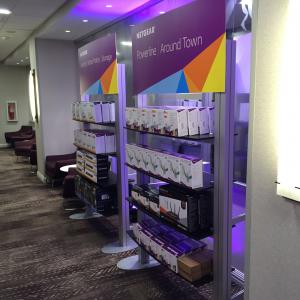 RENTAL: Ballroom Product Showcase with (8) RE-1207 Counters with Custom Laminated Tops, (32) Small Custom Black Laminated Product Shelves, (8) RE-1229 Large Monitor Kiosks, (8) Modified RE-1253 Freestanding Shelf Displays -- Image 3