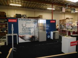 Custom eSmart Sustainable Inline with Tension Fabric Graphics, Showcase Tower, Locking Counter, Closet, and Aero Overhead Hanging Sign