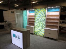 Custom Eco-Systems Modular Inline Exhibit with Multiple LED Lightboxes, Storage Closet, Slant Shelving, Monitor Mount, Slant Shelving, Backlit Reception Counter, (4) MoD01329 iPad Swivel Stands, and (4) Charging Ports