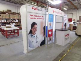 Custom Hybrid Display with Large Monitor Mount, Attached Counter with Locking Storage. Fabric and Direct Print Graphics