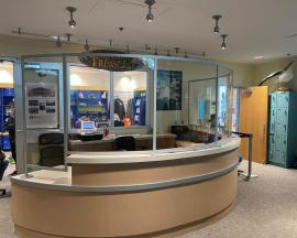 Curved Reception Desk Safety Dividers Constructed with Engineered Aluminum and Clear Acrylic