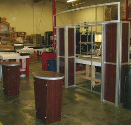10' x 10' Visionary Designs Display with Tapered Pedestals and a Custom Header