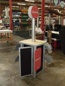 MOD-1227 Workstation with Metal Brochure Holders, Storage, and Sintra Signage -- Image 1