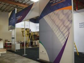 Engineered Aluminum Extrusion Island Exhibit with Silicone Edge Graphics (SEG) and Custom Counters -- Image 1