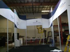 Engineered Aluminum Extrusion Island Exhibit with Silicone Edge Graphics (SEG) and Custom Counters -- Image 3