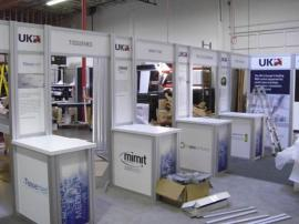 RENTAL Exhibit -- 20' x 30' Island with Internal Workstations (shown with graphics) -- Image 1