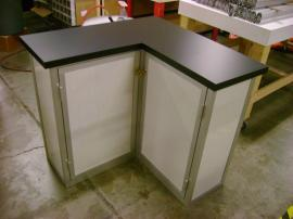 L-Shaped Counter with Two Doors, Storage, and Crate