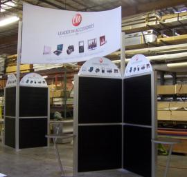 20' x 20' Island Exhibit Rental with Slatwall and Tension Fabric Header